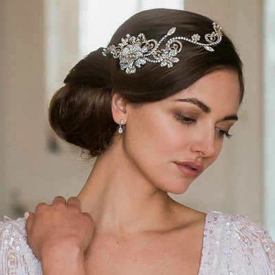 Garden of Beauty Wedding Headpiece shown in a side chignon hairstyle