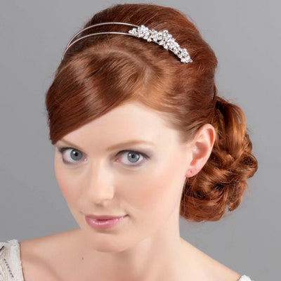 Model bride wears Garland of Love Vintage Headband in a tousled wedding hairstyle