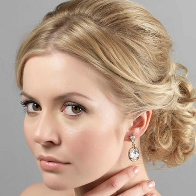 Golden Society drop bridal earrings shown on our model bride