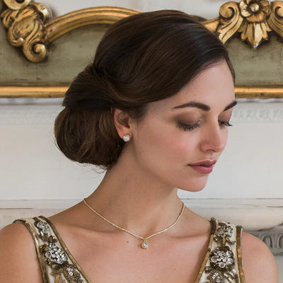Model bride wears Golden Starlet Dainty Crystal Pendant