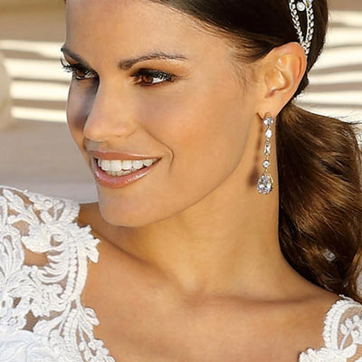 Model bride wears Grace of Gold Drop Earrings