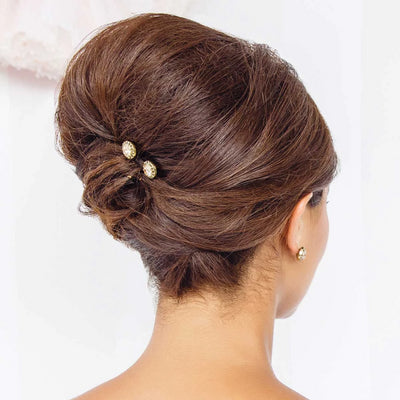 Luxe Treasure Gold Crystal Hair Pins styled in a French pleat hairstyle