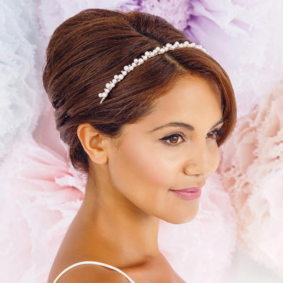 Misty Rose Pink Pearl Headband shown in a French pleat bridesmaid hairstyle