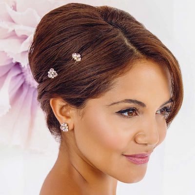 Model bride wears Paradise Pink Gold Stud Earrings
