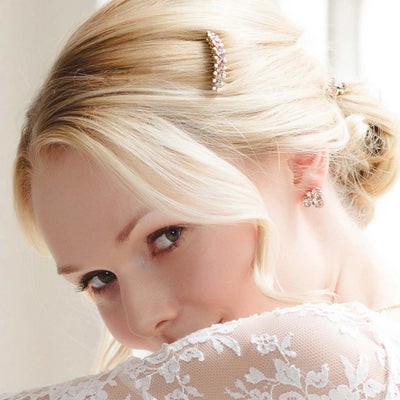 Paradise Pink Gold Stud Wedding Earrings shown on our model bride