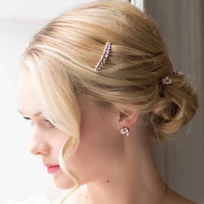 Model bride wears Paradise Pink Gold Hair Comb in a tousled updo
