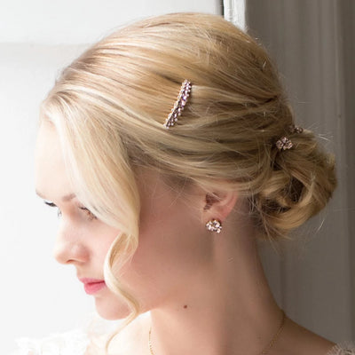 Model bride wears Paradise Pink Crystal Hair Pins in a wedding updo