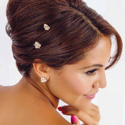Peach Passion Crystal Hair Pins shown in a chic wedding updo