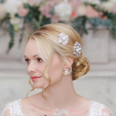 Pearl Blossom Bridal Hair Slide shown in a chic wedding updo