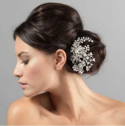 Pearl Bouquet Bridal Headpiece shown in a side chignon hairstyle