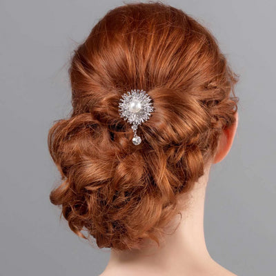 Model bride wears Pearl Burst Bridal Hair Pin in a wedding updo