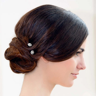 Pearl Dust Hair Pins shown in an elegant bridal side chignon