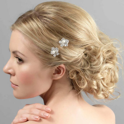 Pearl Posy Wedding Hair Combs shown in a tousled bridal hairstyle