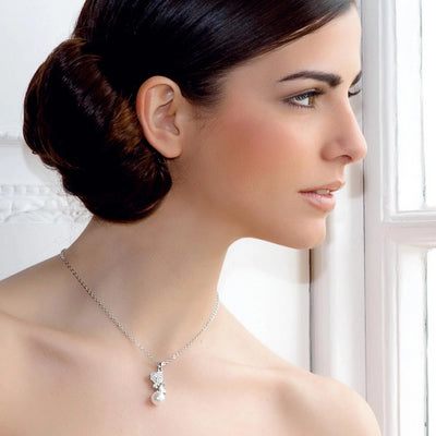 Pearls and Love Hearts Wedding Pendant shown on our model bride