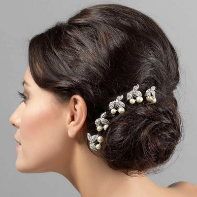 Pearls of Elegance Wedding Hair Combs shown in a bridal side chignon