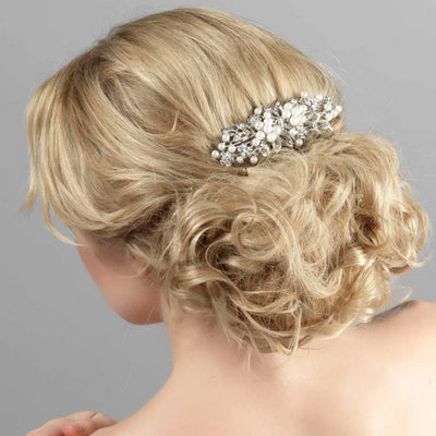 Pearls of Extravagance Bridal Hair Comb shown in tousled wedding updo