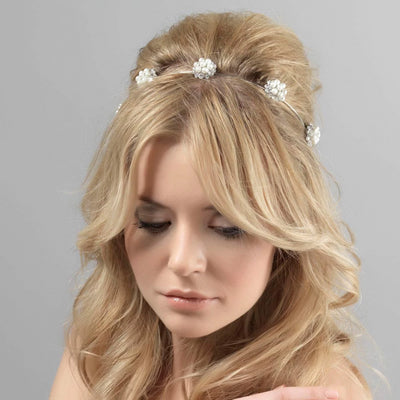Pearls of Grace Bridal Headband shown in a stylish half up wedding hairstyle