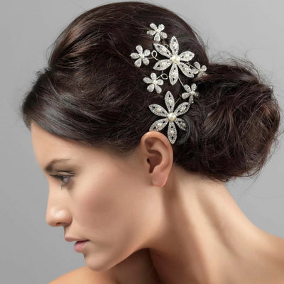 Pearls of Grace Large Wedding Headpiece shown in a wedding updo
