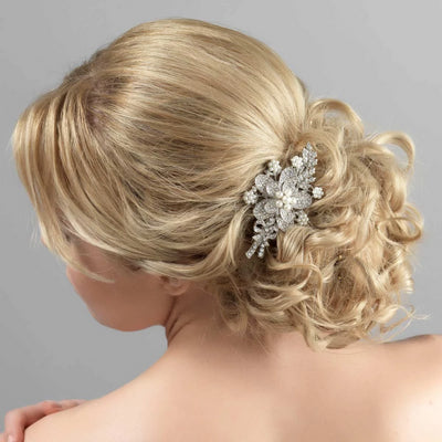 Pearls of Romance Flower Hair Clip shown in a tousled wedding updo