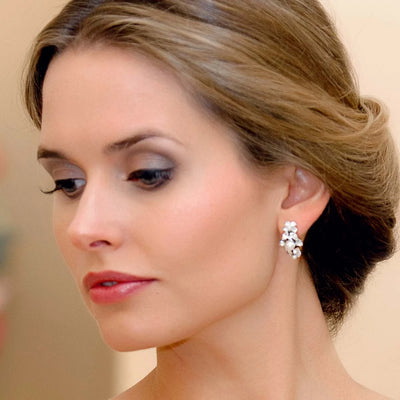 Model bride wears Pearls of Splendour Wedding Clip On Earrings