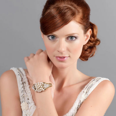 Model bride wears Pearls of the Past Vintage Wedding Bangle