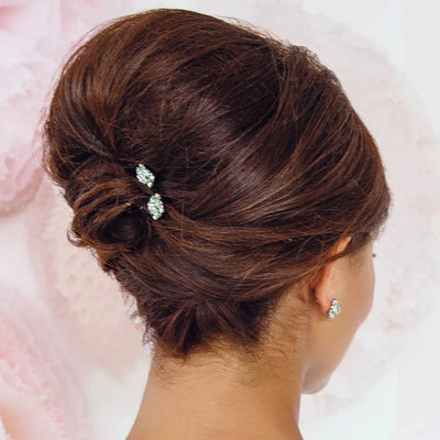 Model bride wears Peppermint Dream Green Bridal Hair Pins in a chic updo