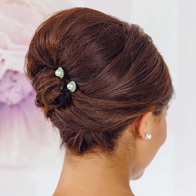 Perfect Pistachio Green Pearl Hair Pins shown in a wedding updo