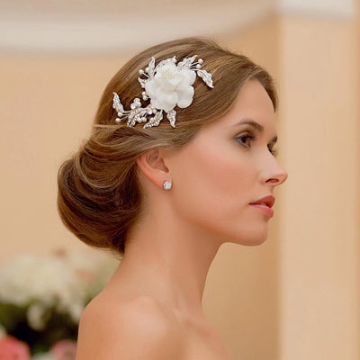 Petals of Eternity Wedding Hair Flower shown in an elegant bridal updo