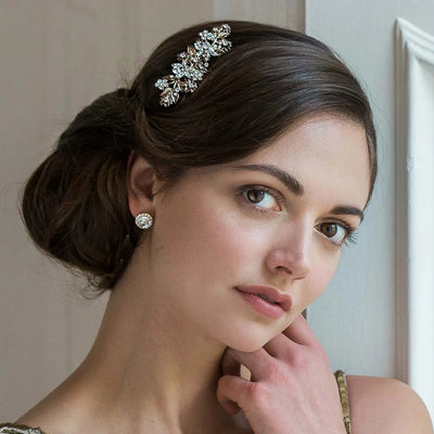 Petals of Gold Flower Hair Comb shown in an elegant wedding chignon hairstyle