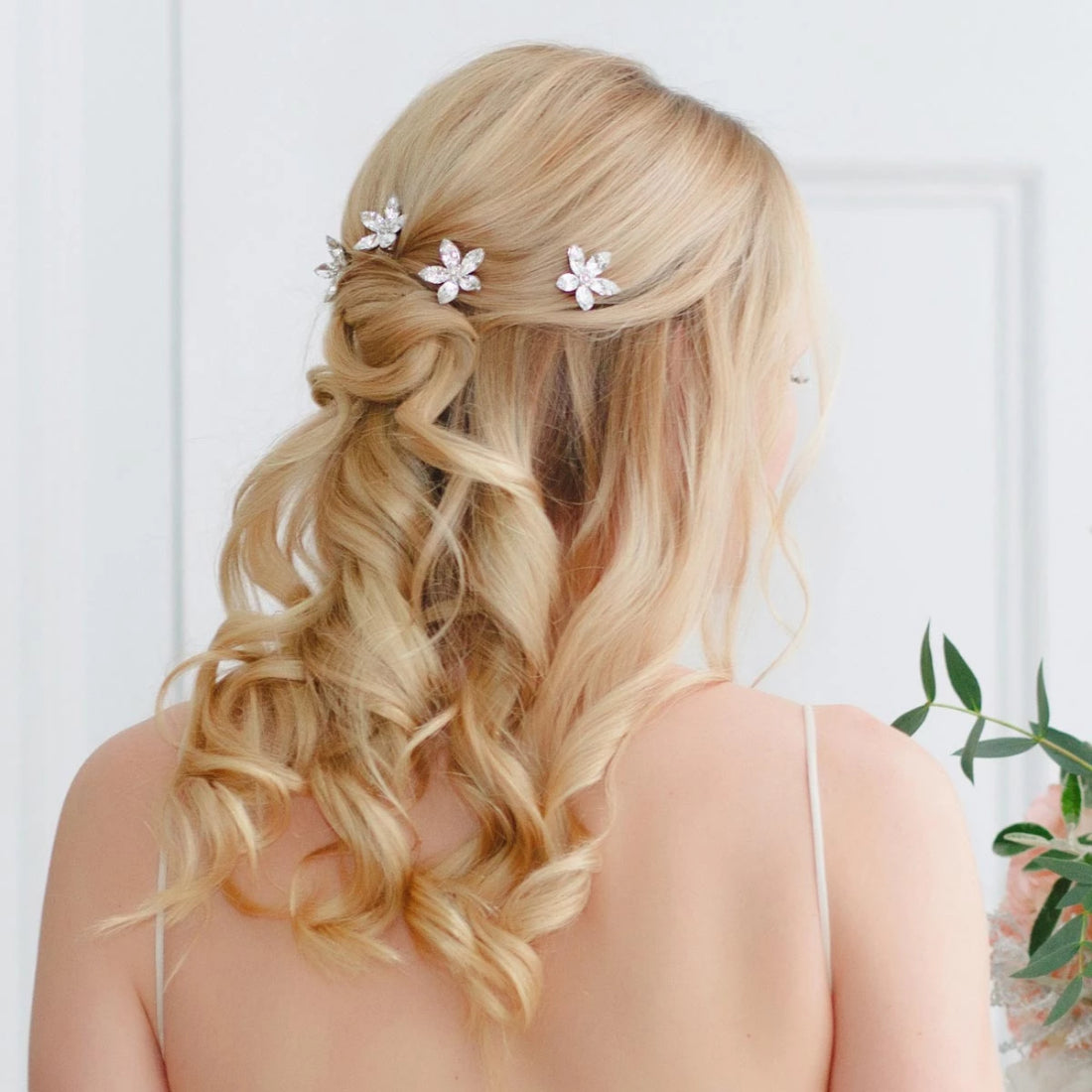 Petals of Love Crystal Hair Combs shown in a bridal half up hairstyle