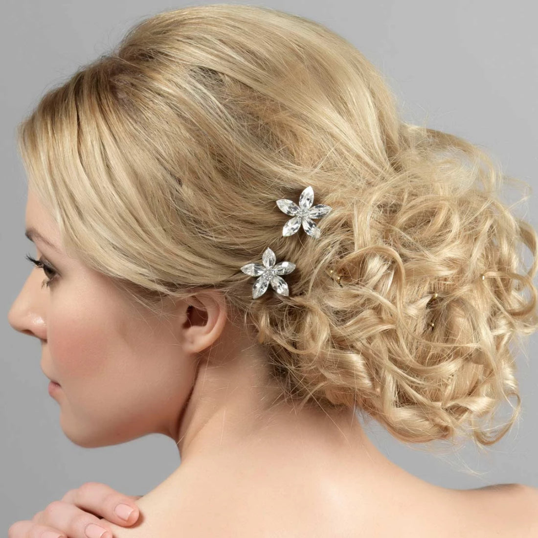 Petals of Romance Gold Hair Combs shown in a tousled wedding chignon