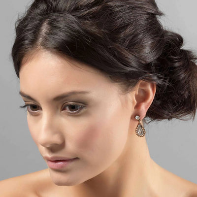 Model wears Princess of Style Gold Crystal Drop Earrings