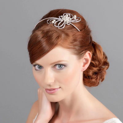 Ribbons and Pearls side bridal tiara shown in a side chignon hairstyle