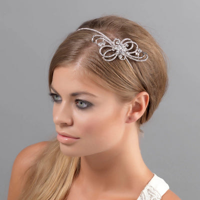 Ribbons of Beauty bridal side tiara shown in a low bridal hairstyle