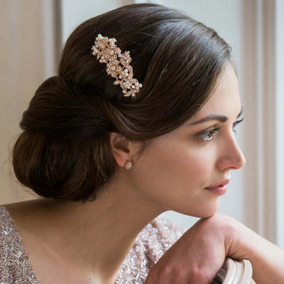 Rose Gold Blooms bridal hair comb shown in a low chignon hairstyle