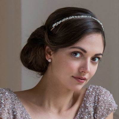 Rose Gold Charm bridal headband shown in a side chignon hairstyle