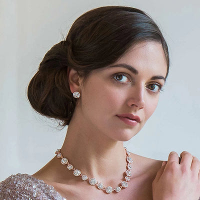 Rose Gold Starlet bridal earrings shown on our model bride