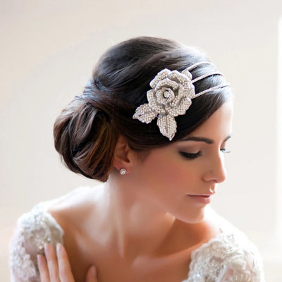 Rose of Eternity Bridal Side Tiara shown in a side chignon hairstyle