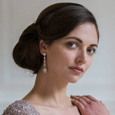 Rose of Grace bridal earrings shown on our model bride
