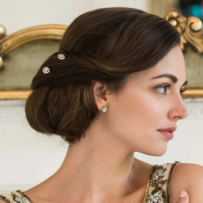 Shimmer of Peach bridal hair pins shown in a side chignon hairstyle