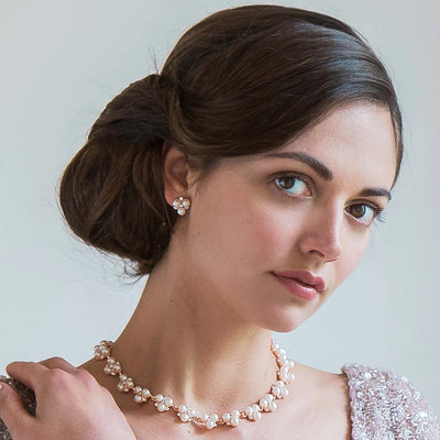 Shimmer of Rose Gold Stud Bridal Earrings shown on our model bride