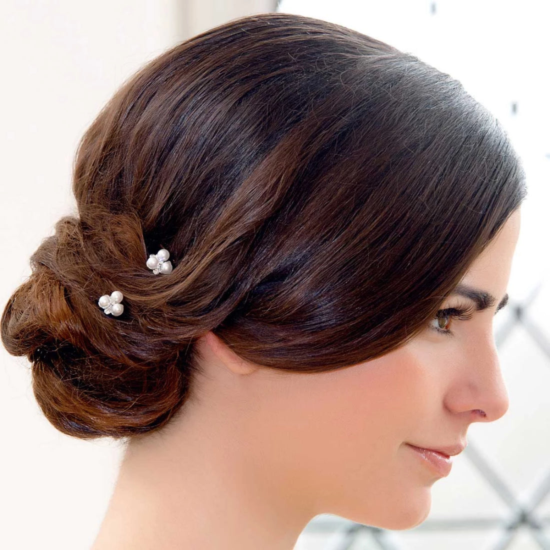 Simply Pearl Hair Pins shown in a side chignon hairstyle
