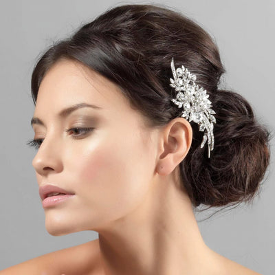 Sparkling Extravagance Bridal Headpiece shown in a side chignon hairstyle