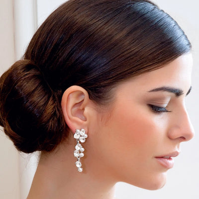 Sparkling Pearl Bridal Earrings shown in a side chignon hairstyle