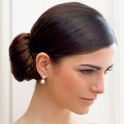 Model bride wears Timeless Elegance Pearl Drop Earrings