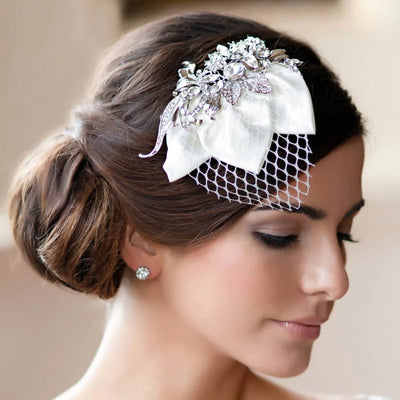 Timeless Petals Birdcage Veil Headpiece styled in a side chignon hairstyle