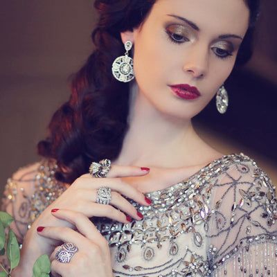 Model wears Vintage Heiress Smoky and Clear Crystal Drop Earrings