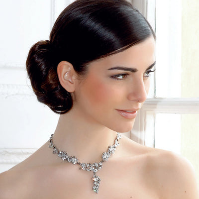 Vintage Treasure Crystal Bridal Necklace as shown on our model bride with hair in a side chignon hairstyle