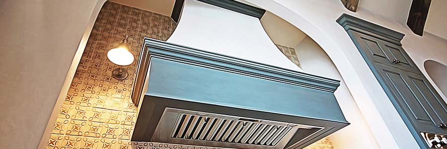 curved range hood with trim and drywall