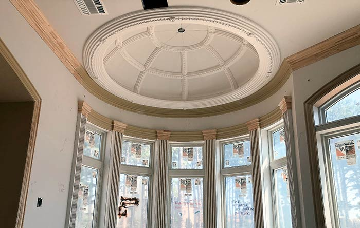 A detailed Dome Ceiling with moldings in a federal-style oval room